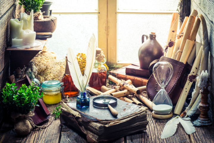 58075919 - unique witch workshop full of scrolls and recipe
